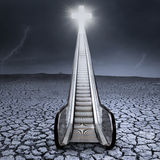 Escalator to the cross on dry land Royalty Free Stock Photo