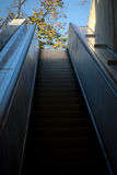 Escalator to light. Going upwards with the help of an escalator Stock Images
