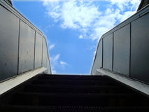 Escalator to the sky. Escalator to the blue sky Stock Photo