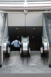 Escalator to Subway. Man descends an Escalator to Subway Royalty Free Stock Photos