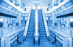 Escalator in trade center Stock Photos