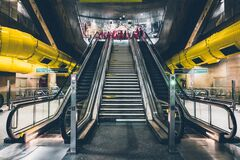 Escalator in train station Stock Photo