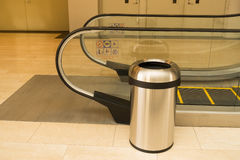 An escalator and trash in department store, Trash. Royalty Free Stock Photo