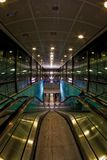 Escalator Tunnel At Airport. The escalator leads to the railroad station built underground at the Helsinki airport in Finland. The tunnel has a somewhat Royalty Free Stock Photos