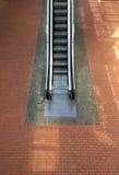 Escalator. Upward with brick tile floor on background Royalty Free Stock Image