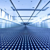 Escalator view in blue corridor Royalty Free Stock Images