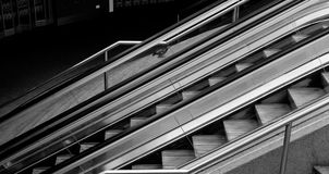 Escalators. Black and White image of two outdoor escalators Royalty Free Stock Photography