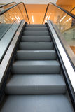 Escalators. A automatic escalators in business building Royalty Free Stock Photos