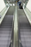 Escalators. Blurred escalator with people on it Stock Images