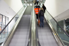 Escalators. Blurred escalator with people on it Royalty Free Stock Image