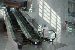 Escalators. In modern corporate building Royalty Free Stock Photo