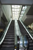 Escalators. Two escalators going up and down Royalty Free Stock Image