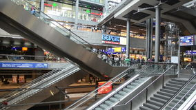 Escalators in Berlin central railway station. With many people and shops stock video footage
