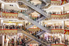 Escalators, busy mall. Modern shopping mall with crowded people,Guangxi,China Royalty Free Stock Images
