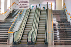 Escalators in Cirkewwa ferry terminal, Malta. Two escalators in Cirkewwa ferry terminal, Malta. Was shot in summer 2015 Stock Images