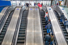 Escalators with commuters at North Greenwich underground station Royalty Free Stock Photography