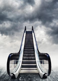 Escalators, conceptual image. Moving stairway to heaven. Easy opportunity to success Royalty Free Stock Photography