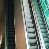 Escalators. In different floors stock images