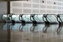 Escalators. Five escalators side by side in a terminal Stock Image