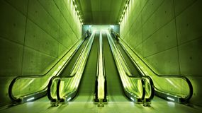 Escalators in green light