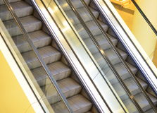 Escalators. Image of parallel escalators inside a shopping mall Royalty Free Stock Photography