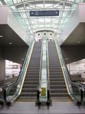 Escalators inside an airport. This photograph is taken on portland airport on 10.13.2014 royalty free stock photos