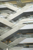 Escalators in the interior of office building, Paris, France Stock Photo