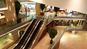 Escalators in a modern shopping mall. Modern architecture of a retail financial super market fitted with glass walls and railings in Mumbai, India Stock Images