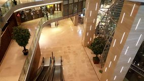 Escalators in a modern shopping mall. Modern architecture of a retail financial super market fitted with glass walls and railings in Mumbai, India Stock Photo