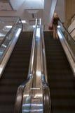 Escalators Motion with Woman Stock Image