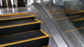 Escalators are moving  that constantly run upstairs. Escalators are moving  that constantly run upstairs, Stair and escalators in a public area stock footage