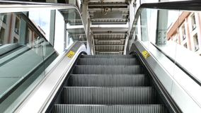 Escalators are moving that constantly run upstairs. Escalators are moving that constantly run upstairs, Stair and escalators in a public area stock video