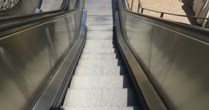 Escalators Going Down. An escalators moving down to lower floor stock video footage