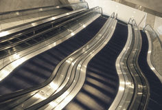 Escalators in office building. Escalators in modern office building with distorted effect Royalty Free Stock Images