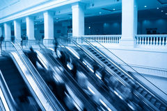 Escalators with passenger motion blur Royalty Free Stock Photo