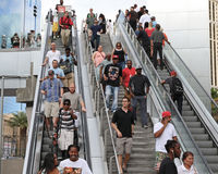 Escalators with people. People going up and down the escalators Royalty Free Stock Photography