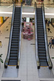 Escalators in a retail shopping mall in Bucharest. Two escalators in a shopping mall in Bucharest. Usually full of people, now empty, just before closing time stock image