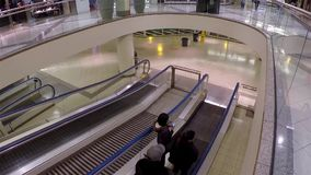 Escalators with shopper coming to superstore at Metropolis shopping mall stock video