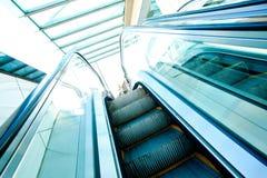 Escalators at the shopping mall Stock Photos