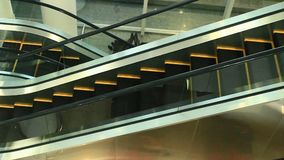 Escalators are shown that constantly run upstairs. The escalators are shown that constantly run upstairs stock video footage