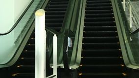 Escalators are shown that constantly run upstairs. The escalators are shown that constantly run upstairs stock video
