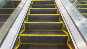 Escalators are shown that constantly run upstairs. Escalators help facilitate travel.escalators are shown that constantly run upstairs stock footage