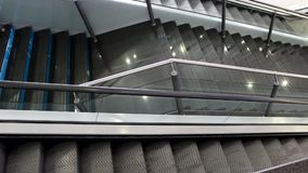 Escalators,staircase. Moving staircase going up and down in business center stock footage