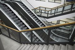 Escalators and stairs Stock Images