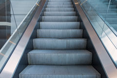 escalators stairway inside modern office building Royalty Free Stock Image