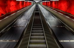 Escalators at the Stockholm metro or tunnelbana station Solna Ce. Escalators at the Stockholm underground metro or tunnelbana station Solna Centrum with fire royalty free stock photos