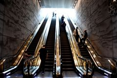Escalators in Triangeln Station. Four escalators are transporting people into underground floor in the Triangeln station in Malmo, Sweden. The modern style is Royalty Free Stock Photo