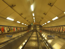 Escalators on the way to tube, London England Stock Photography