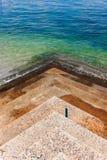 Escalera abajo al mar Imágenes de archivo libres de regalías