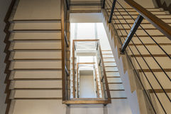 Escalera con el carril de madera Imagen de archivo libre de regalías